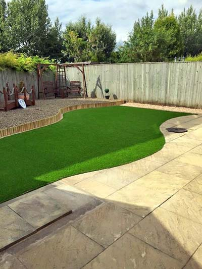 A garden we landscaped in Wakefield, showing the lawn and decorative paving we laid.