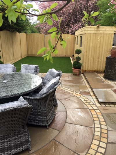 A garden we landscaped in Leeds, showing the fence and shed we erected, and the decorative paving we laid.