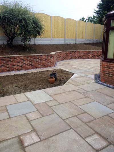 A garden in Pontefract, West Yorkshire, where we erected a fence, built a garden wall and laid some decorative paving.