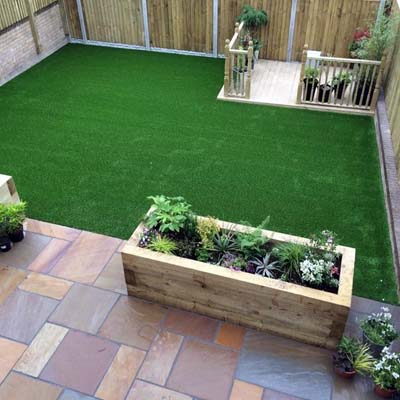 A garden in Castleford, where we built a raised flowerbed, and laid decorative paving and a lawn.